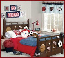 """The Half-Time Sports Bed is the ideal piece for the sports loving child in your family. The ''Dark Cherry"""" bed features straight lines and popped out images of a basketball, soccer ball and footballs"""