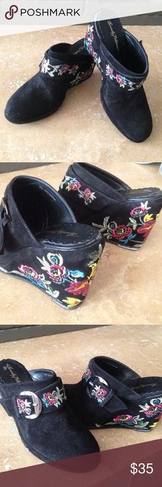 Beverly Feldman Floral Embroidered & Beaded Clogs Details: These boho black suede pre-owned clogs have embroidery in red, blue, green and gold with black beads. There is a gold-tone buckle to tighten, which has one hole.  The buckle has some slight discoloration.   Size: 6M In great condition Beverly Feldman Shoes Mules & Clogs