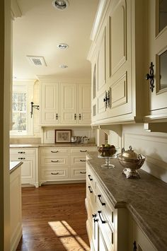 Soft antique white cabinets with marble counter tops.  Designer Notebook by Kathryn Greeley North Carolina interior designer. Absolutely my favorite kitchen look.
