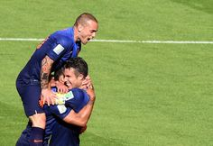 Netherlands' forward Memphis Depay (C) celebrates with Netherlands' midfielder Wesley Sneijder (L) and Netherlands' forward and captain Robin van Persie after scoring their third goal during a Group B football match between Australia and the Netherlands at the Beira-Rio Stadium in Porto Alegre during the 2014 FIFA World Cup on June 18, 2014.