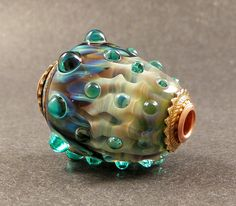 Teal Wavy Pleats and Petals Cored and Capped by PeggySudzLampwork
