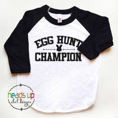 This adorable Egg Hunt Champion shirt is perfect for your little one. Use it to celebrate the fun of Easter, or spring, or just to make someone laugh. Its a great everyday wear shirt - sure to be a favorite. It also makes a great gift! It is made using high quality heat transfer vinyl and come on a white/black shirt. Other Colors/Designs Available! (Please see my other listings) **SIZING** We use the American Apparel brand shirts. These shirts tend to run big/true to size. *...