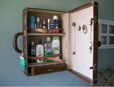 Suitcase turned medicine cabinet.