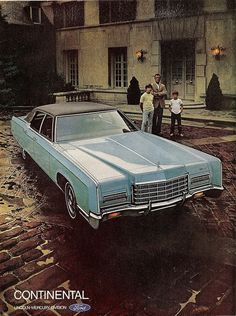 1972 Lincoln Continental, these youngsters don't look too excited about Dad's new ride....but then Dad doesn't exactly look like a barrel of laughs either. Great car though!!