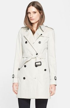 Free shipping and returns on Burberry London 'Kensington' Double Breasted Trench Coat at Nordstrom.com. Classic trench styling—including storm flaps, epaulets and belted definition—elevate this double-breasted coat to urban-chic, weather-defying status. For an undeniably Burberry London touch, pop the brisk collar to reveal iconic checks hidden beneath.