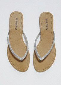 Sparkle and shine on any summer night in these gorgeous crystal flip flops!  Metallic flip flops features rhinestone crystal embellishment.  Availble in Metallic Silver and Rose Gold in select stores and online.  Fully lined. Imported.