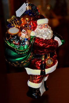 Christopher Radko Santa ornament. Found at Design with Consignment in Austin, Texas. We have a variety of Christopher Radko ornaments available in our showroom. Can also be seen at DWConsignment.com