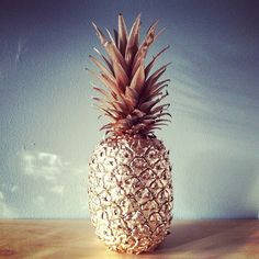 Beach weddings and tropical weddings - what a cute inexpensive idea. Spray paint pineapple as center pieces.