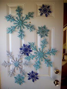 Easy snowflakes - dollar store acrylic snowflakes - painted white for a base color - brush on glue and sprinkle on different color glitter - easy, inexpensive and beautiful.
