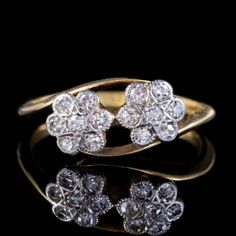This wonderful Antique cluster ring has a lovely twisted design fashioned in Yellow Gold with two White Gold Diamond encrusted flowers placed in the centre of two flowing curves. Antique Diamond Rings, Antique Engagement Rings, Diamond Flower, Diamond Cuts, Twist Ring, Perfect Engagement Ring, Cluster Ring, Star Shape, White Gold Diamonds