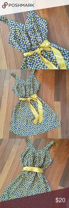 """Elephants Don't Forget...and Neither Will They Elephants Don't Forget...and Neither Will They, When They See You in this Adorable Summer Dress. Says large but runs small more for a medium. Navy blue and yellow gold colors. Can be tied in front or back with ribbon. Length from shoulder to hem: 32"""" Elastic waist laying flat: 14"""". Stretches to 18"""" Bust flat: 18"""" I am a 38C was too tight in bust. Moonlight Dresses Mini"""