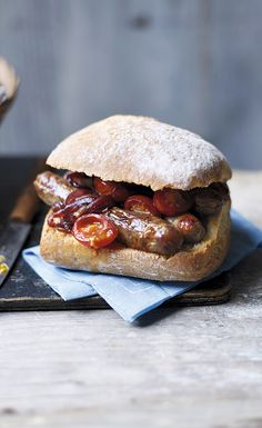 Grilled Lincolnshire sausages topped with warm cherry tomatoes and sticky red onion – a quick and warming weekend brunch recipe. Find more Waitrose recipes on our website.