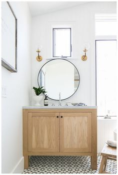Need to update your bathroom? Check out these twenty one-of-a-kind beautiful farmhouse bathrooms that, we have to admit, we're totally obsessed with.  #ModernFarmhouseInteriors #ModernFarmhouseBathroom #RusticFarmhouse #FarmhouseStairs #ModernFarmhousePlans #FarmhouseIdeas #FarmhouseDesign #BathroomRenos #BathroomInterior Oak Bathroom Vanity, Master Bath Vanity, Laundry Room Bathroom, Wood Bathroom, White Bathroom, Small Bathroom, Master Bathroom, Bath Room, Bath Vanities