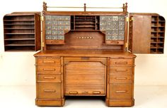 Wells Fargo Indianapolis Rotary Oak Roll Top Desk Circa Take a look at all the options this desk offers (see site) It's advertised as a Wooton desk, but I think it's post Wooton and made in the Wooton style. Upscale Furniture, Cool Furniture, Furniture Design, Antique Desk, Antique Furniture, Old Desks, Elegant Homes, My New Room, Wood Crafts