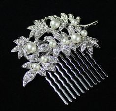 Hey, I found this really awesome Etsy listing at http://www.etsy.com/listing/110764126/victorian-style-wedding-hair-comb-pearl