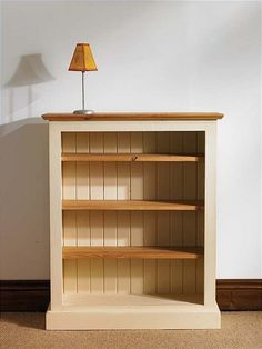 Paint and stain wooden bookshelf, light color for a small condo, but still wood tones