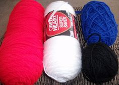 """Collect your Supplies! Bright Red and Soft White are """"Red Heart Super Saver"""" and the Blue and Black are """"Impeccable""""      Make a swatch....."""