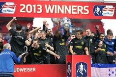~ Wigan Athletic celebrating their win over Manchester City to become Champions of the FA Cup ~