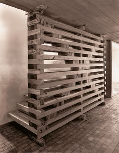 Thinking of having a kitchen partition like this where the slats essentially go into each other to form a single door and come out when you want to cover the whole space
