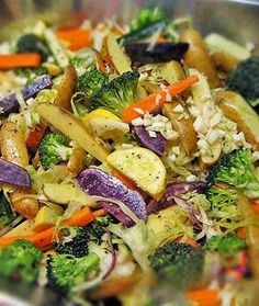 Cabbage, zucchini, broccoli, sweet potato, red onion, carrots, olive oil and salt. nice warm meal.