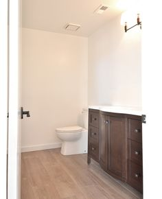 Contemporary toilet and flat-topped baseboards.