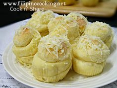 Ensaymada or ensaimada is one of the oldest Filipino breads and a variation of Spanish bread. This is often spiral or twirly in shape and is topped with creamed butter, sugar, and cheese.