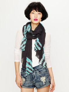 I love tie dye!  It always adds a fun pop of color.  Free People Tie Dye Travels Scarf, $128.00