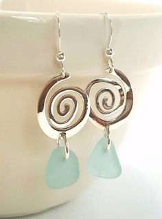 "Striking Sterling Silver spiral wire earrings highlighted by genuine, flawless, ocean-tumbled and rare deep aqua sea glass gems from Northern California. Earrings measure 1/2"" by 1 1/2"". All component More #seaglassearrings"