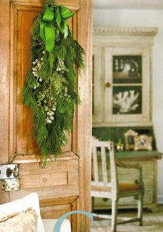 Beautiful winter greens swag.  I <3 the soft, wintery color scheme in this photo.