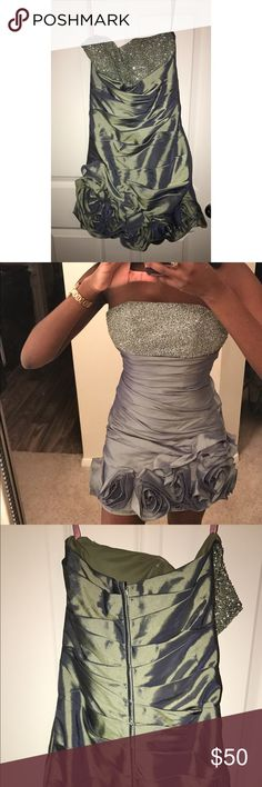 Prom dress My beautiful prom dress only worn once its kind of hard to pick a color for what color it is but I'd describe it to be a metallic grayish green (sounds crazy I know) but it's soo pretty (: Blush Prom Dresses Prom