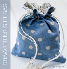 There& no need for wrapping paper when you have a Drawstring Gift Bag Free Sewing Pattern at your disposal. If you& looking for free sewing patterns for beginners, this is the perfect project for you to try. Drawstring Bag Pattern, Drawstring Bag Tutorials, Small Drawstring Bag, Drawstring Backpack Tutorial, Tote Pattern, Sewing Patterns Free, Free Sewing, Purse Patterns, Diy Pochette
