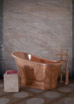 Bijou 1250mm Copper - Our Copper collection continues to expand with The Bijou. Our fresh take on a classic, distinctly French single slipper bateau bath first used in 19th Century. Its unusual high ended design adds a touch of 'je ne sais quoi' to the bathing experience. Perfect for smaller spaces. #Bath #Baths #Bathing #Copper #Nickel #Luxury #NewDesign #Decorex #Bespoke #Hurlingham