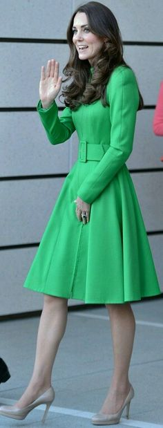 Love this coat and shoes; accents her figure so well... green looks great on her.. not my choice for me.  I would love it in red or blue!