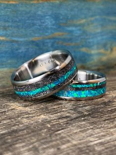 His and hers handmade opal wedding ring set from RobandLean. Meteorite Ring, Titanium Rings, Meteorite Wedding Band, Opal Wedding Ring Set, Wedding Band Sets, Wedding Rings Sets His And Hers, Commitment Rings, Alternative Wedding Rings, Engagement Rings For Men