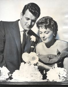Film actor Rock Hudson, 29, and Phyllis Gates, 25, former executive assistant to actor's business manager, cut wedding cake after their surprise marriage Wednesday night in Santa Barbara. Description from latimesblogs.latimes.com. I searched for this on bing.com/images