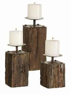 "Uttermost 11"" Kelton, Candleholders, S/3 Recycled, Old Wooden Planks With Metal Details by Uttermost. $173.80. Material: Iron And Wood. Turning the old into something new. These rustic candleholders are made from recycled, old wooden planks with antique metal details. White candles included. Sizes: Sm-4x7x4, Med-4x9x4. Lg-4x11x4"