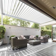 An IQ Lux patio roof was used in this contemporary home renovation to extend living spaces further into the garden. The automated louvre roof sits over the large patio area jointly supported by the building, leg posts and the boundary wall. Diy Pergola, Gazebo, Pergola Ideas, Louvered Pergola, Outdoor Garden Furniture, Outdoor Decor, Outdoor Shelters, Outdoor Living Rooms, Outdoor Spaces