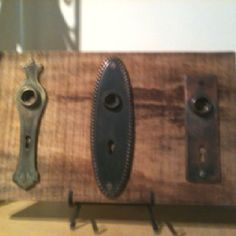 Quick and easy wall art - attach escutcheon plates to an old board