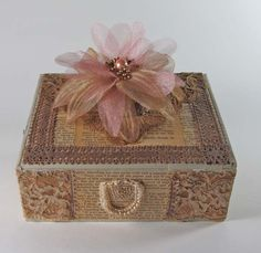 Lace, Flower, and decoupaged old pages on a cigar box base.