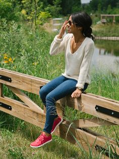 Cute fall style with a basic white sweater and jeans. Add a pop of pink with Reebok Skyscape sneakers in a polka dot pattern.