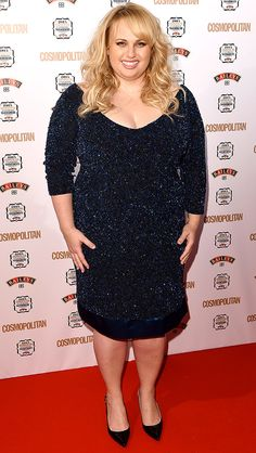 REBEL WILSON in a sparkly long-sleeve Theia dress