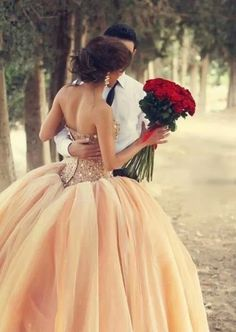 Wow. Bride looks like a princess with roses from her prince charming