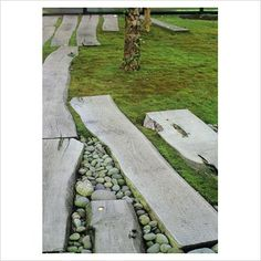 Zen style moss garden with paving slab path and pebbles at Millburn, New Jersey, USA