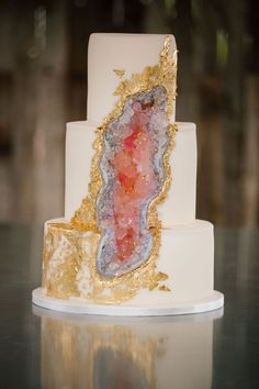 We can't stop staring at this geode wedding cake from Carrie's Cakes and are struggling to believe that those quartz inspired crystals aren't real!