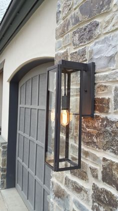 Vista Wall Extra Large An outdoor lantern with an industrial, modern design, the Vista lantern is an updated option for the traditional lantern. This lantern is available in 3 sizes. Garage Lighting, Outdoor Wall Lighting, Outdoor Walls, Outdoor Lantern, Lighting Ideas, Contemporary Outdoor Lighting, Modern Exterior Lighting, Modern Outdoor Lights, Lantern Lighting