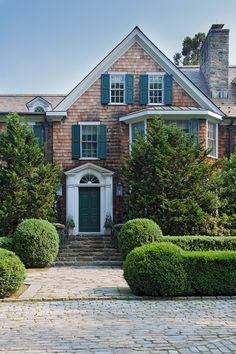 Weathered shingled home, pretty boxwoods - Mount Holly, Bedford, New York.