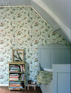 I love attic ceilings - reminds me of our old house... Blue bed. Cole & Son humming birds wallpaper .