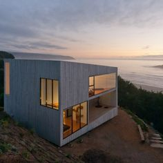 D House. This two-storey house situated at the top of a cliff in Matanzas, Chile was designed by Panorama. Architecture Design, Residential Architecture, Amazing Architecture, Contemporary Architecture, Concrete Architecture, Architecture Wallpaper, Architecture Interiors, Small House Swoon, Haus Am Hang