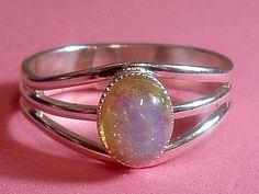 Val Kirsch design silvery fire opal triple band ring