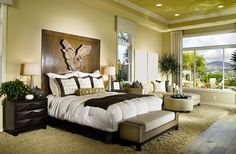 Custom decorated master bedroom with large window views